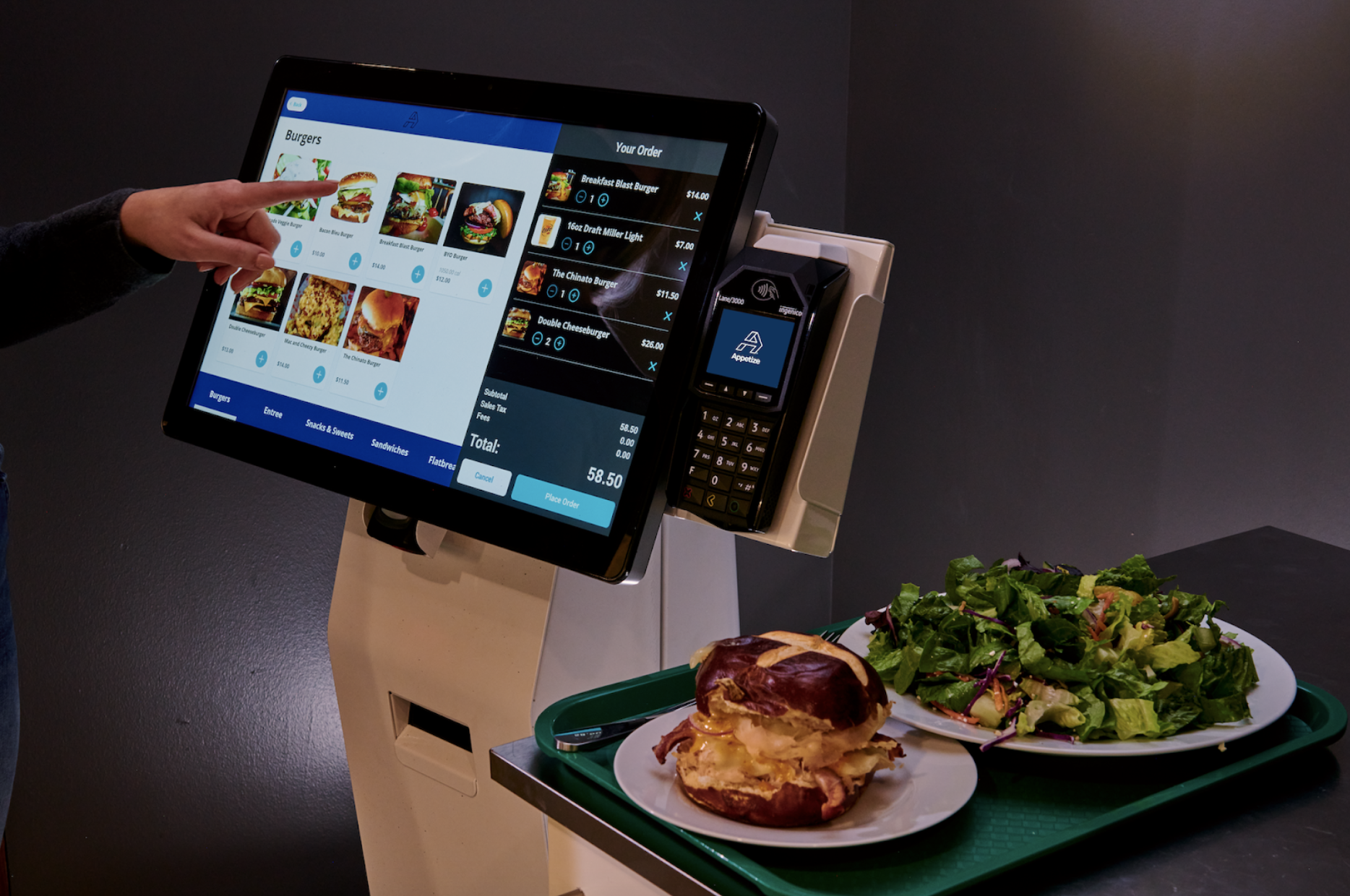 a laptop computer sitting on top of a plate of food
