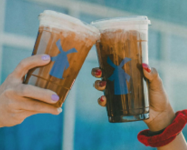 a hand holding a plastic cup
