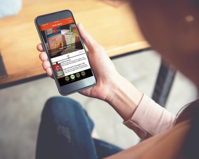 a hand holding a cellphone
