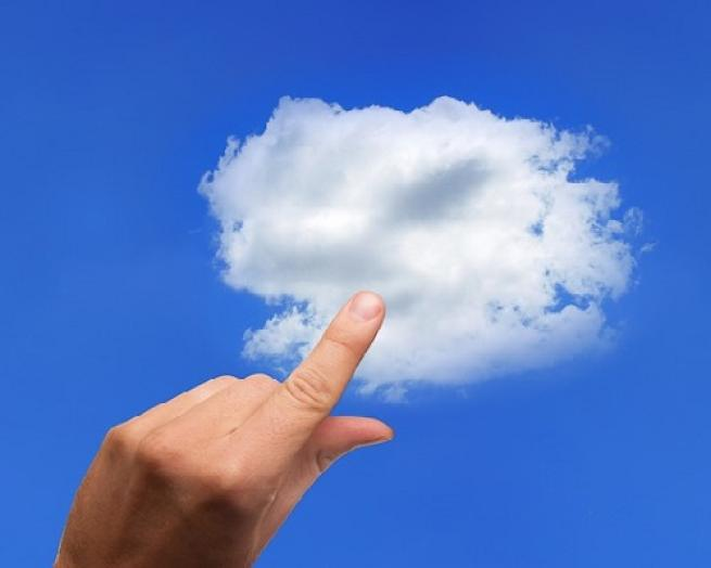 a hand holding a clear blue sky