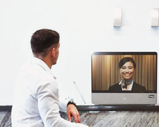 a man standing in front of a television