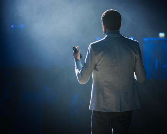 a man standing on a stage