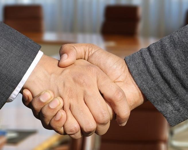 a handshake deal partner