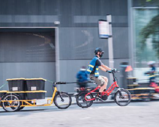 a man riding a bicycle to deliver restaurant food
