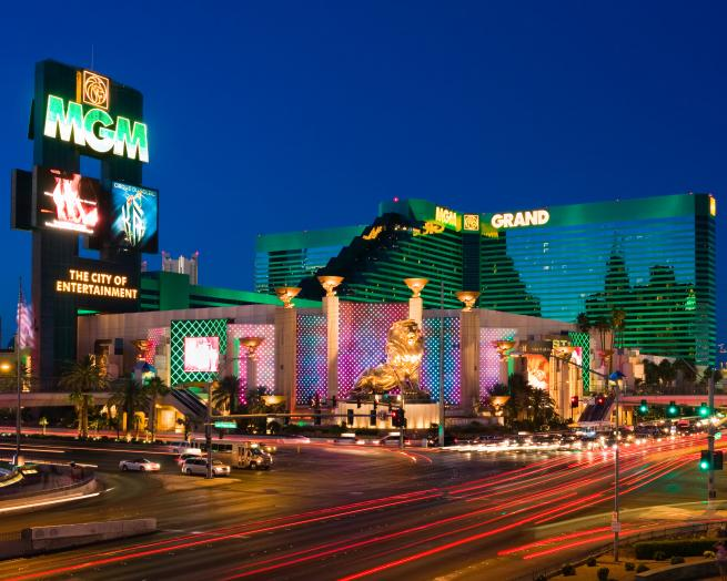 a lit up city at night with MGM Grand Las Vegas in the background