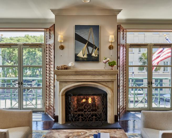 a fireplace in a living room filled with furniture and a fire place